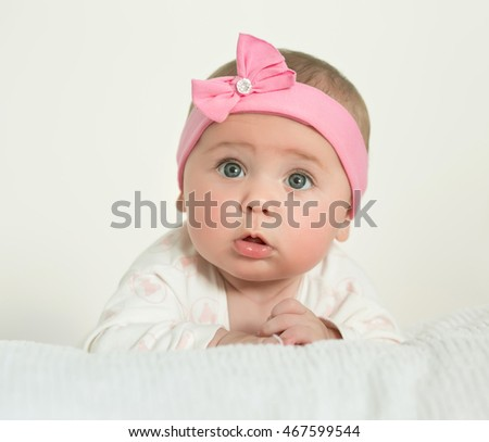 Portrait of the girl of the baby with a pink bow