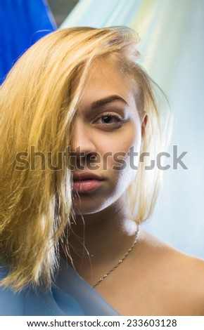 Portrait of the girl with interesting by a hairdress - stock photo