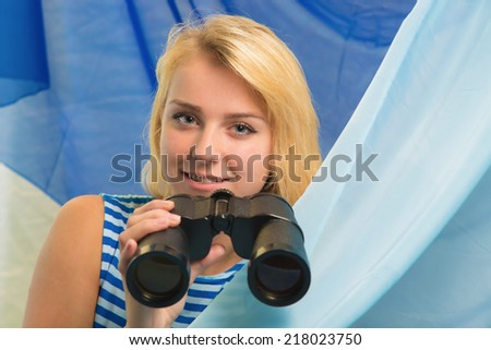 Portrait of the girl with the field-glass - stock photo