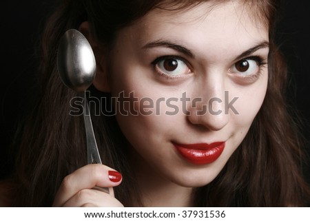 Portrait of the girl with the spoon in a hand.