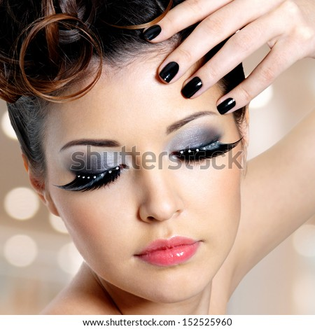 Portrait of the glamour woman with black nails and   fashion eye makeup