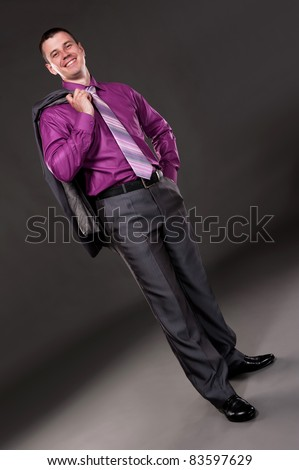 Portrait of the groom in studio on a grey background - stock photo