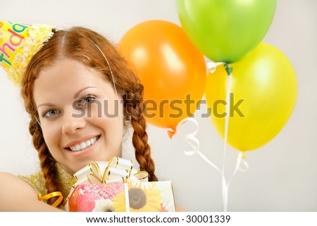 Portrait of the happy birthday woman with gifts
