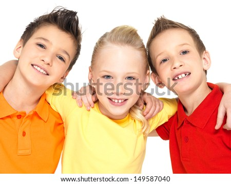 Portrait of the happy children isolated on white.  Schoolchild friends standing together and looking at camera