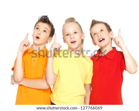 Portrait of the happy children point up with idea sign -  isolated on white