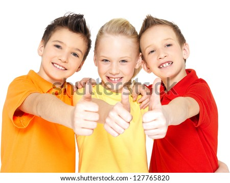 Portrait of the happy children with thumbs up gesture  isolated on white. - stock photo
