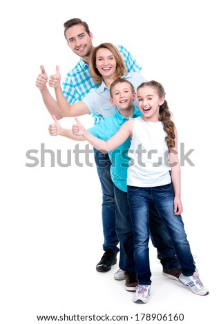 Portrait of the happy european family with children shows the thumbs up sign -  isolated on white background