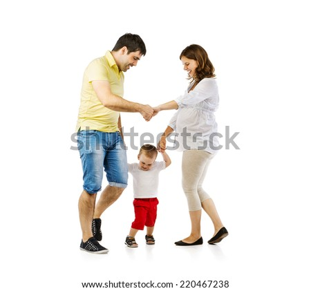 Portrait of the happy family with little boy and pregnant mother playing, isolated on white background - stock photo