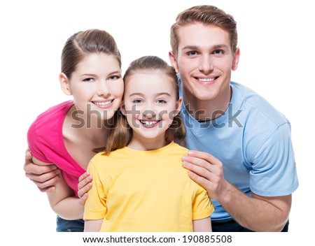 Portrait of the happy young family with child in multicolor shirts - isolated on white background. - stock photo