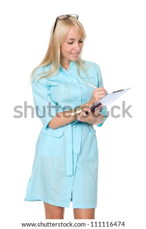 Portrait of the happy young nurse of filling paper on a white background - stock photo