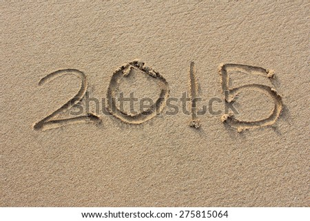 "portrait of the inscriptions ""2015"" on sand beach"