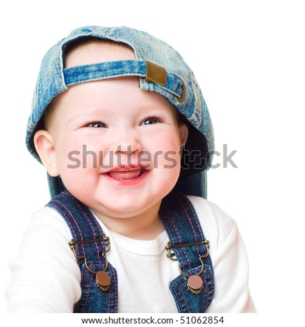 Portrait of the kid in a jeans cap - stock photo