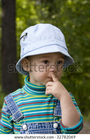 Portrait of the little boy on a summer wood background - stock photo