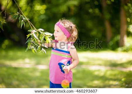 Portrait of the little girl outdoors