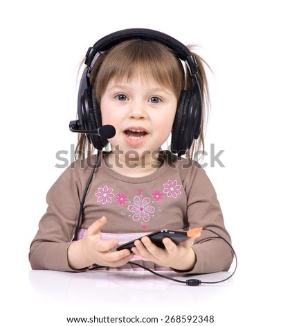 Portrait of the little girl's positive that the headphones listening to music, isolated on a white background. - stock photo