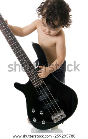 Portrait of the little; guitarist on a white background. - stock photo