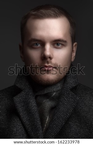 portrait of the man in a coat - stock photo