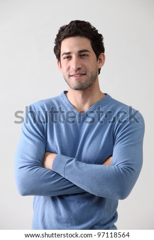 portrait of the man on the plain background - stock photo