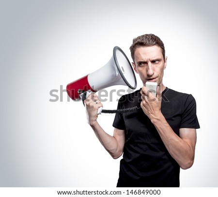 Portrait of the man with megaphone.Listening his inner voice. Isolated on white. - stock photo