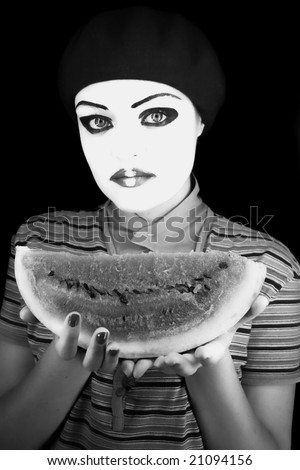 Portrait of the mime  with a water-melon piece