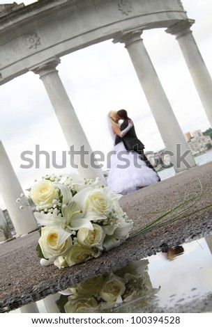 portrait of the newlyweds on studio shooting - stock photo