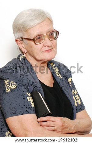 Portrait of the old woman with the book on a light background - stock photo