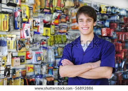 portrait of the proud owner of a home improvement stores with tools in the background