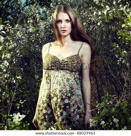 Portrait of the romantic woman in a summer garden - stock photo