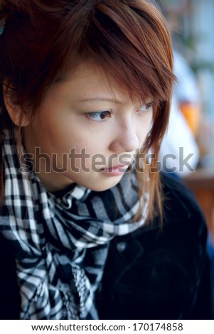 portrait of the serious girl looking sideways - stock photo
