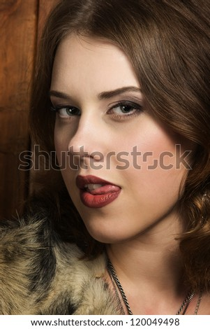 Portrait of the sexy woman in a fur - stock photo