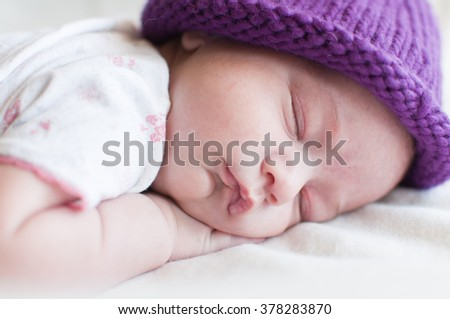 Portrait of the sleeping baby in hat - stock photo