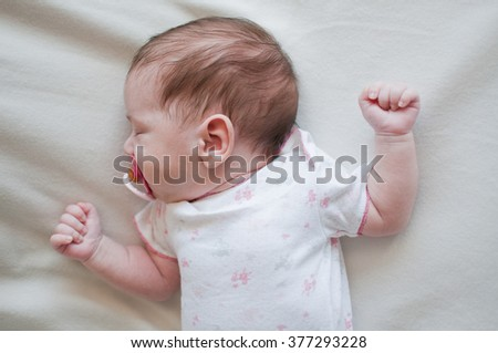 Portrait of the sleeping baby with red nipple