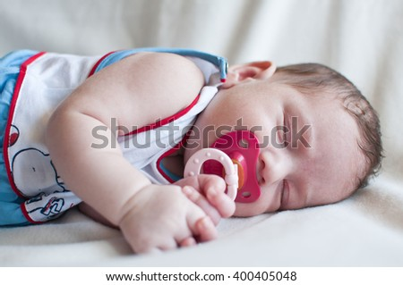 Portrait of the sleeping baby with red nipple - stock photo