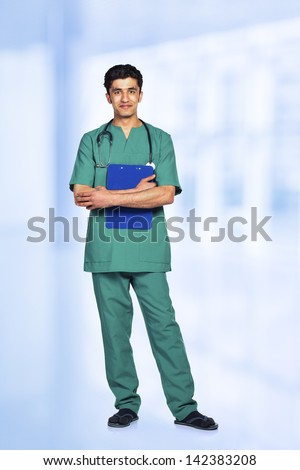 Portrait of the smiling arab doctor on interior background - stock photo