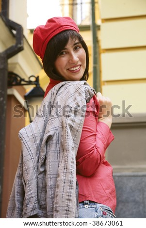 Portrait of the smiling girl in an orange beret