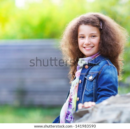 Portrait of the smiling happy little girl outdoor
