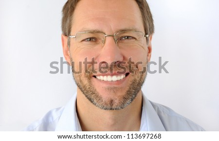 Portrait of the smiling man isolated on white background