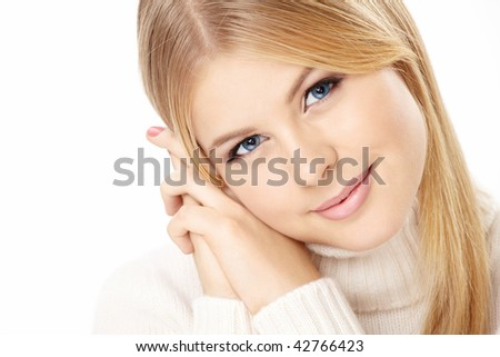 Portrait of the smiling pretty blonde isolated