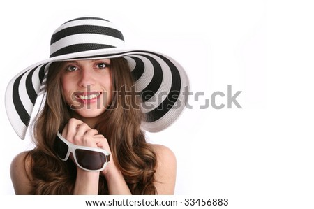 portrait of the smiling  white woman in striped hat with copy-space - stock photo