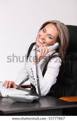 Portrait of the Smiling young business woman calling by phone