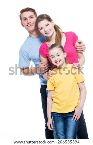 Portrait of the smiling young family with kid in multicolor shirts - isolated on white background.
