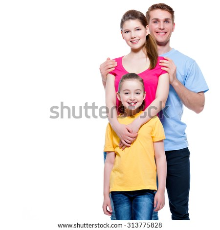 Portrait of the smiling young family with kid in multicolor shirts - isolated on white background. - stock photo
