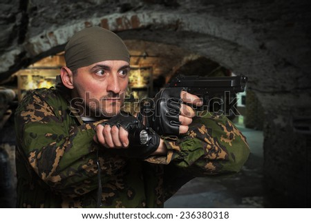 Portrait of the soldier with the gun in hands