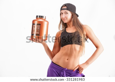 portrait of the sports girl with jar of protein
