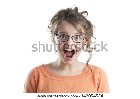 Portrait of the surprised pretty girl in glasses for vision. Studio photography on a white background. Age of child 10 years. - stock photo