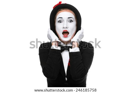 Portrait of the surprised woman as mime isolated on white background. Concept of surprise and admiration - stock photo