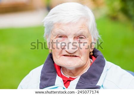 Portrait of the sweet smiling elderly grandmother - stock photo