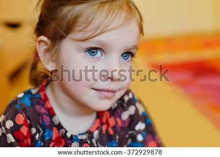 portrait of the sweet toddler girl with blue eyes - stock photo