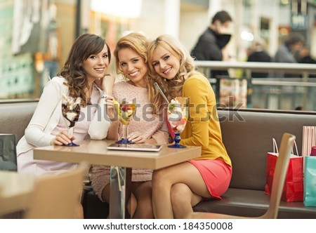 Portrait of the three young cheerful girlfriends - stock photo