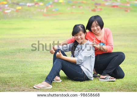 Portrait of the two asian woman outdoors